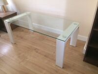 Beautiful glass surface with white legs coffee table