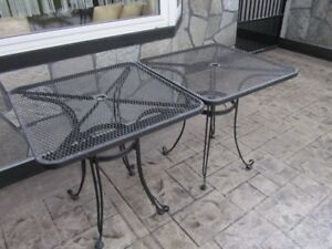 2 metal outdoor t black tables  in good shape