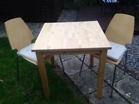Good as new table and chairs