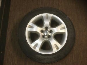 Toyota Rims And Goodyear Snow Tires.