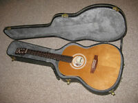 Canadian made acoustic guitar and hard shell case