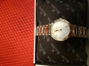 Lady's Bulova watch with 3 diamonds.