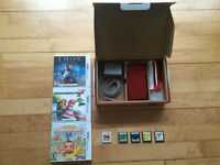 Nintendo 3DS in box w/ games