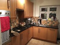 IKEA kitchen cupboards and work tops, sink and Beaumatic oven, job, extractor fan.
