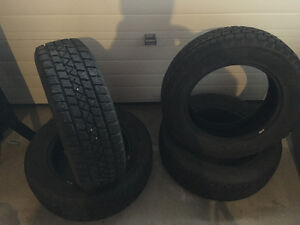Studded Arctic claw winter tires 255/65/17
