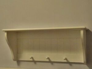 Decorative White Shelf with Hooks