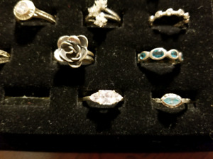 .925 Sterling silver rings and 1 stainless steel spinner ring