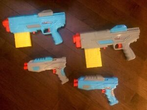 Four nerf guns and ammo