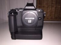 Olympus EM-5 with 2 part grip not Nikon, canon, sony, Pentax, lumix