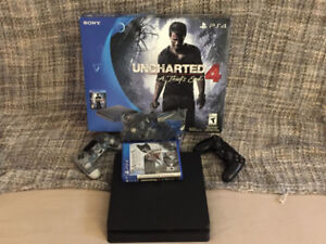Ps4 slim 500gb for sale + 2 games and 2 controllers