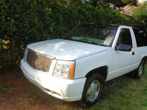 GMC Yukon  ( conversion escalade)