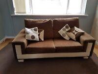 2 brown sofas