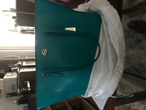 Selling Brand new Tote Coach Bag with a zipper for $180.00!