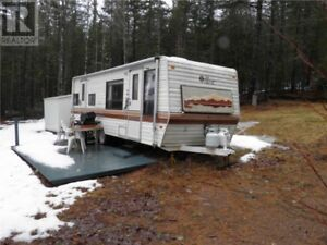 2 Acres of land with a travel trailer, baby barn & driveway!!