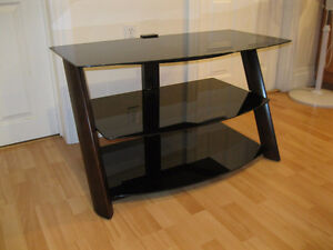 PRICE DROP Beautiful 3 tier smoked glass T.V. Stand like new .