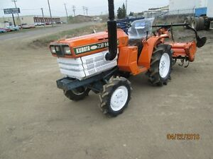 4X4 KUBOTA TRACTOR  B1402 DT  W  ROTOR TILLER  3 POINT HITCH