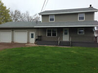 IN THE HEART OF SHEDIAC 4 BEDROOMS DOUBLE CAR GARAGE