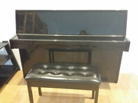 Yamaha upright piano C109 with bench