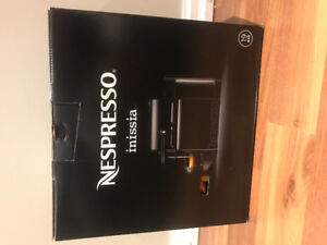 Brand new black Nespresso inissia with samples inside