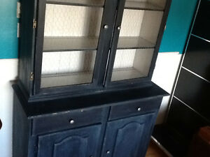 Country blue solid wood display with chicken wire doors.