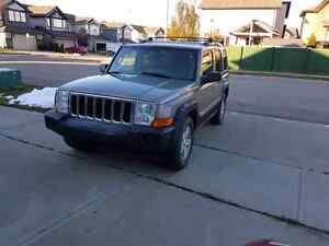 5.7L Jeep Commander 4x4 auto 141k fully loaded  BEST OFFER