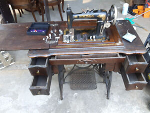 1900 New Idea Sewing Machine with attachments