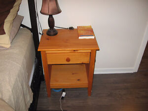 1 dresser and 1 nightstand with 1 lamp and 1 clock radio