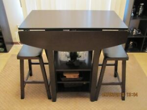bar height table and 2 stools