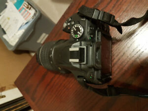 Nikon D5100 with Nikkor 18-55mm lens in great condition