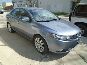 $5495.00  2010 Kia Forte SX Sedan