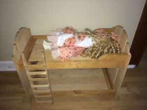 Porcelain doll and wooden bunk bed