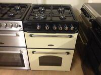 Cream/black gas cooker