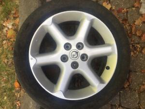 """2002 Nissan Maxima17"""" rims + tires"""