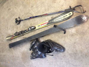 Downhill skis. poles and boots