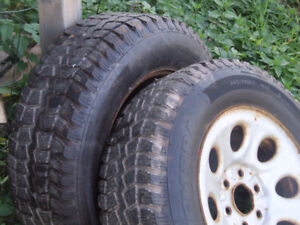 """2 Studded 17"""" Winter Tires on Rims."""