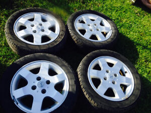 Nissan Sentras rims and tires.