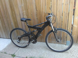 """Used mountain bike with 18"""" aluminum frame and dual suspension"""
