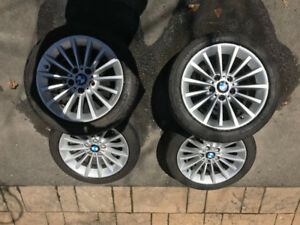 "17"" BMW OEM mags with tires."