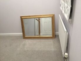 Mirror with gold coloured frame excellent condition