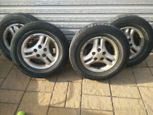 4 summer tires Toyo Eclipse with mags 215-70r15.  200$