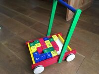 Childrens push along wooden trolley and building blocks