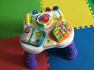 Vtech sit to stand learn and discover table and ride on/walker