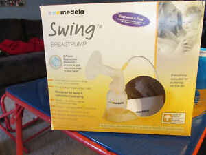 Medela swing single breast pump with extras