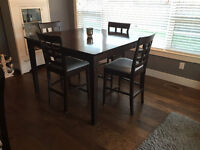 Table with matching chairs, newly recovered cushions