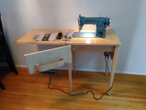 Ogilvy's own sewing machine table