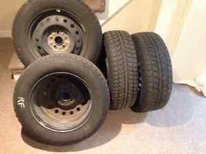 4 used Uniroyal snow tires including rims
