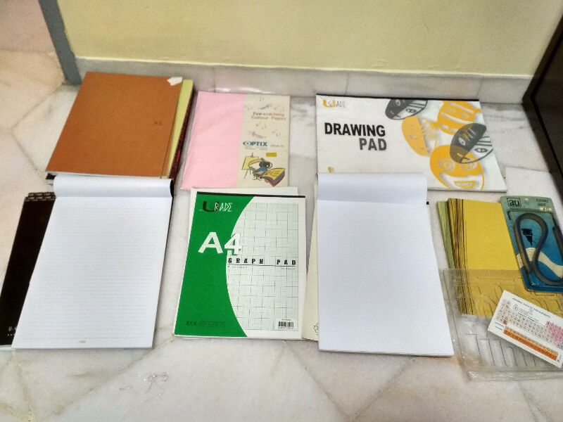 Four A4 Writing Pads with lines, five A4 Writing Booklets with lines, one A3 drawing pad