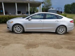 2015 Ford Fusion SE - includes 2.5 years warranty. 12,999