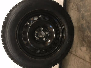 Four Firestone Winter Force snow tires on rims