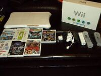 Console, remotes, games and wii board.